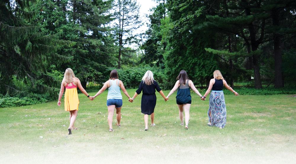 Empowering Women - Friends Holding Hands