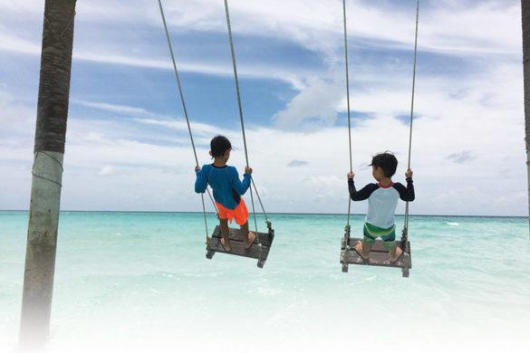 kids play near in the sea