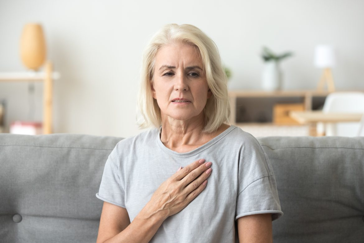 older woman feeling heartache