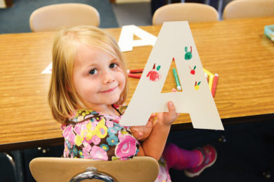 setting your children-girl holding a letter