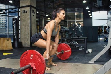 Women Lift Barbell