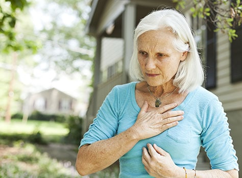 Woman feeling heart attack