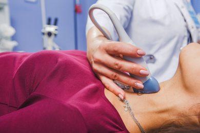 Woman Doing Neck Ultrasound Examination
