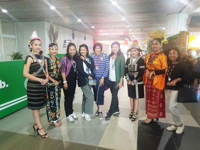 received by ladies in traditional dress